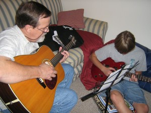 "Iggy Donnelly and Son practicing ""Here comes the Sun"" by Geo. Harrison"